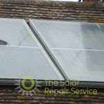 Torn solar thermal flat panel on roof